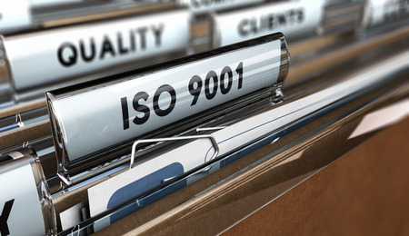 standardization: Close up on a file tab with the word ISO 9001, focus on the main text and blur effect. Concept image for illustration of Quality Standards
