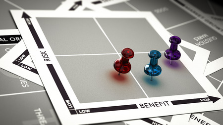 Risk versus value matrix with pushpins and blur effect. Concept of investment risk assessment. Banque d'images