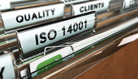 standardization: Close up on a file tab with the word ISO 14001, focus on the main text and blur effect. Concept image for illustration of Quality Standards Stock Photo