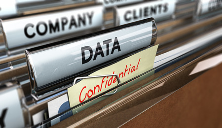 secret information: Close up on a file tab with the word data and confidential, focus on the main text and blur effect. Concept image for illustration of company data protection. Stock Photo