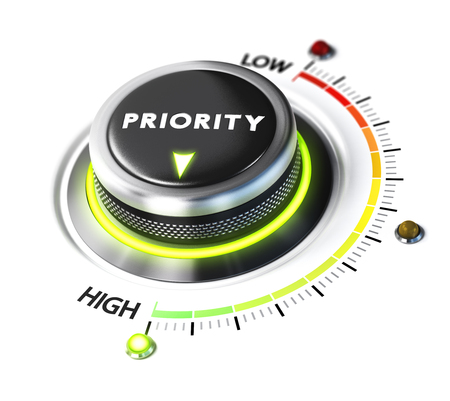 priorities: Priority switch button positioned on highest level, white background and green light. Conceptual image for illustration of setting priorities and time management. Stock Photo