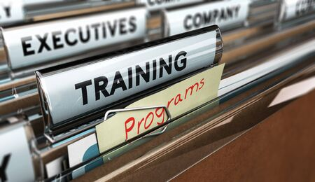 programm: Close up on a file tab with the word training, focus on a yellow, note where it is hanwritten programm, blur effect. Concept image for illustration of employee, training