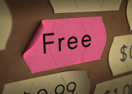 freebie: Free sticker over carton background with yellow prices labels around it. Concept of freebie