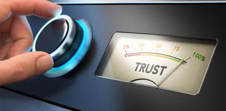 trust: Hand turning a knob up to the maximum, Concept image for illustration of trust in business.