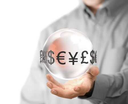 global currencies: Man hand holding glass sphere with currencies around it. Concept image for illustration of currency exchange. Stock Photo