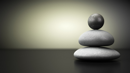 Three pebbles stack over beige and black background, balance stones with room for text on the left. concept image symbol of stability.