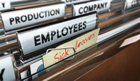 files: Close up on a file tab with the word employees plus a note with the text sick leaves, blur effect at the background. Concept image for illustration of sick leave entilement.