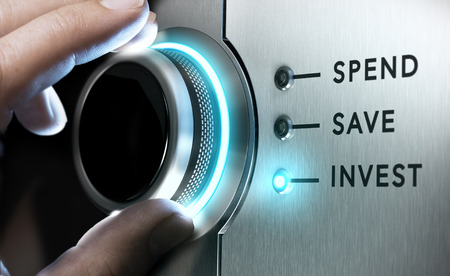 Man hand turning a knob in the invest position,  Concept image for illustration of making an investment versus saving or spending money.