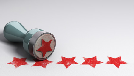 Rubber stamp over paper background with five stars printed on it. concept image for illustration of high customer experience and quality level Standard-Bild