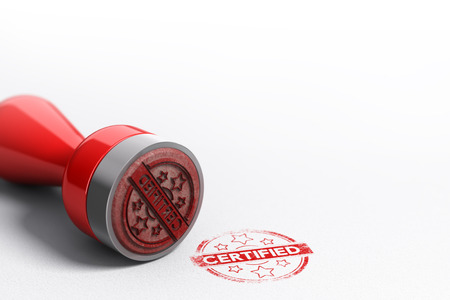 Rubber stamp seal over paper background with the word certified printed on it. Concept image for illustration of certification Standard-Bild