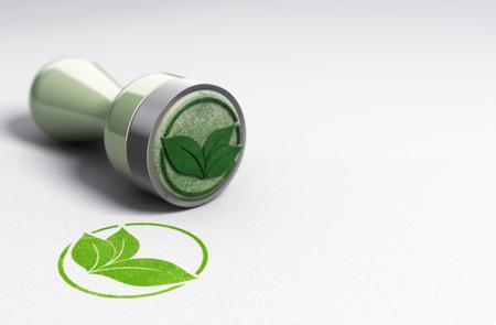 Rubber zegel op papier achtergrond met bladeren symbool gedrukt. Concept afbeelding voor eco vriendschappelijke mededeling. Stockfoto