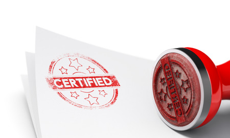 Rubber stamp over paper sheet with the word certified imprinted on it. Concept image for illustration of certificate of authenticity. White background and blur effect.