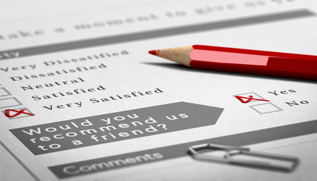 recommendation: Paper survey document with a red wooden pencil. Very positive customer feedback with recommendation to a friend Stock Photo