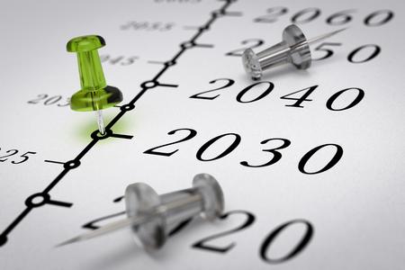 Año 2030 escrito en un papel con una imagen del concepto de alfiler verde, para la visión de negocio o largo plazo prospectivo. El número dos mil treinta años.