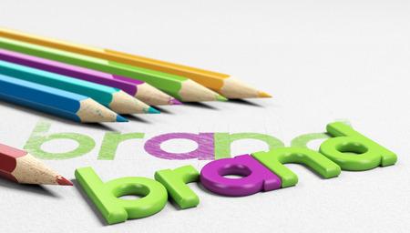 posicionamiento de marca: marca de la palabra escrita a mano en un papel con textura de seis lápices de madera sourounding y un modelo 3D del diseño final. concepto de imagen para la marca y la estrategia de identidad. Foto de archivo