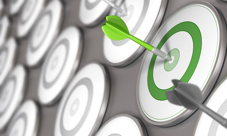 One dart hits the center of a green target with many grey targets around it. Concept image for illustration of business competitiveness. Banque d'images