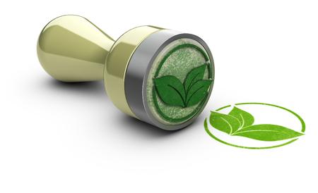 Gummi-Stempel auf weißem Hintergrund mit dem Symbol Blätter darauf gedruckt. Konzeptbild für umweltfreundliche Kommunikation.