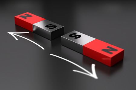 Two dipoles magnets repels eatch other. Black background Stockfoto
