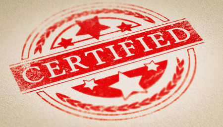 certifying: Rubber stamp imprint over paper background with the text certified. Concept image for illustration of certification or authenticity certificate.