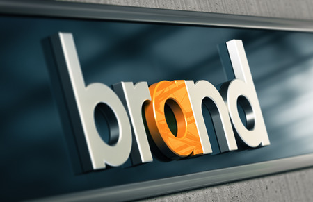 naming: Branding concept. Company brand name on a building facade with blur effect Stock Photo