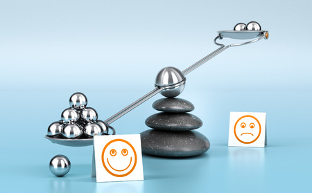 be the change: Metallic spheres on a seesaw with three black pebbles over blue background. Concept image for illustration of wellness or happyness. Stock Photo