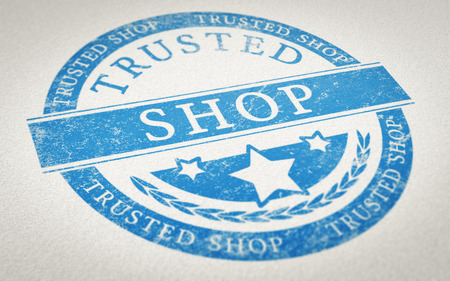 shop online: Rubber stamp imprint over paper background with the text trusted shop. Concept image for illustration of trustworthy online shopping. Stock Photo