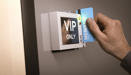 pass: Hand with blue pass card unlocking access to a VIP room. Concept image for illustration of customers exclusive privileges.