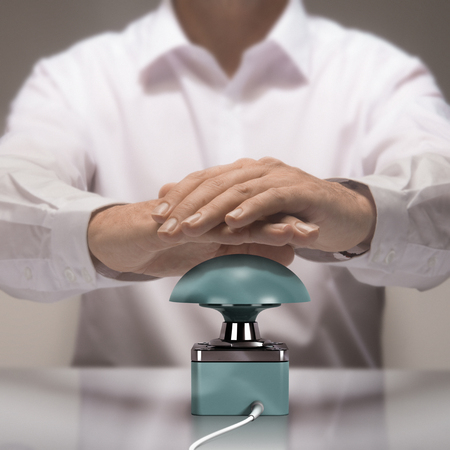 candidate: Image compositing and 3D entre photography buzzer. Man with two hands about to press the button for answering a quiz question. Stock Photo