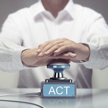 react: Hand about to press an action button. Concept for urgent acting. Composite image between a photography and a 3D buzzer. Stock Photo