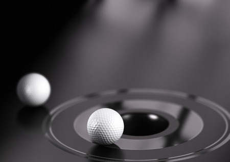 attainment: 3D illustration of golf ball near a hole. Black background Stock Photo