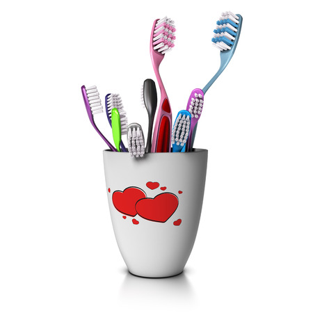 3D illustration of a cup with tooth Many toothbrushes, two for the relatives and seven for the children. Concept image of wide family over white background. Stock Photo