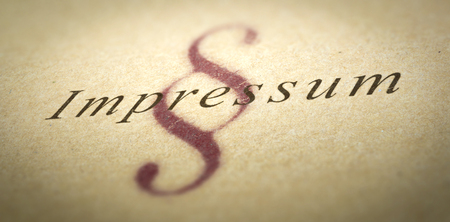authorship: Word Impressum printed on a paper texture with blur effect and silcrow symbol