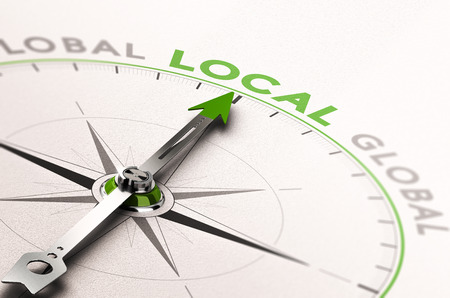 Ilustración 3D de una brújula con la aguja hacia la palabra negocio local. Concepto de una economía ética Foto de archivo