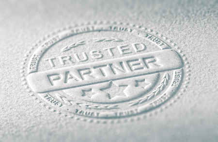 business confidence: 3D illustration of an embossed stamp with the text trusted partner, Paper background and blur effect. Concept of confidence in business relationship. Stock Photo