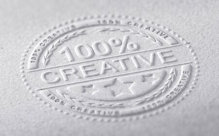 creative communication: 3D illustration of a stamp embossed on a paper texture with the text one hundred percent creative, horizontal image. Communication concept for creative advertising company