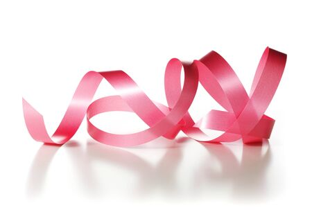 Red ribbon over white background, decorative element.