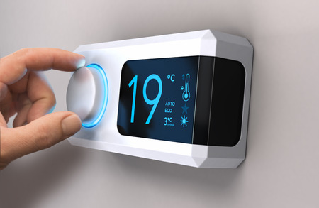 Hand turning a home thermostat knob to set temperature on energy saving mode. Celsius units. Entre composite image photography and has a 3D background.