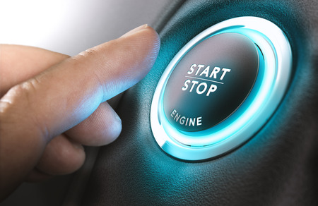 engine: Car stop start system with finger pressing the button, horizontal image Stock Photo