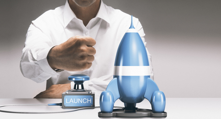Man about to launch a rocketship. Advertising concept of company startup or business boost. Composite between a 3D image and a photography background.