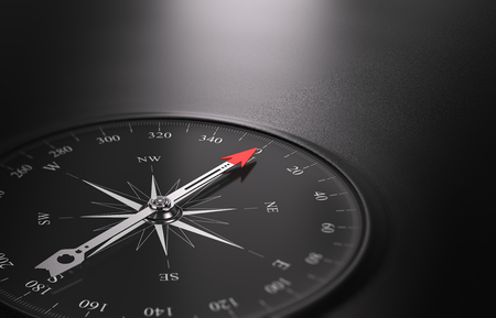 3D illustration of a compass over black background with needle pointing the north direction, free space on the right side of the image. Business or career orientation concept.  Stock Photo