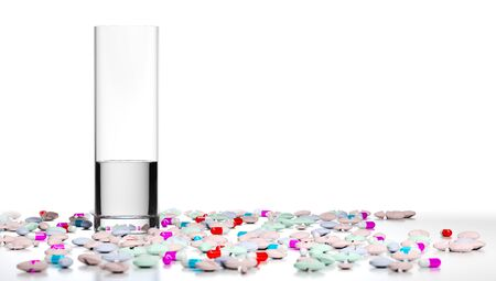white pills: 3D illustration of a glass of water and many pills and tablets around it. Concept of overmedication over white background.