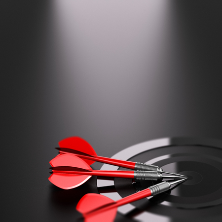 3D illustration of one target and three red darts over black background. Strategic business or marketing strategy concept.  Stock Photo