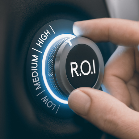 Hand turning knob to select high return on investment, black and blue tones. ROI Concept. Composite image between a hand photography and a 3D background.