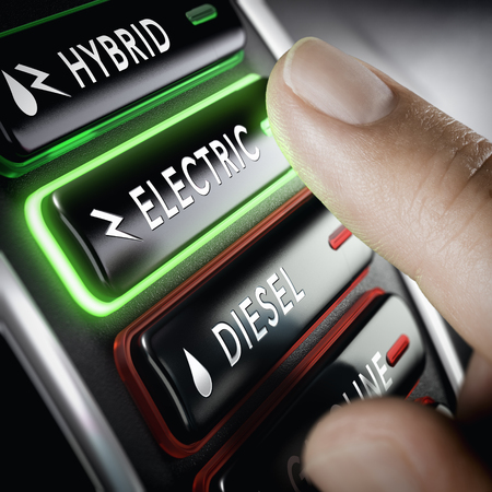 Finger pressing a push button to select electric technology car versus diesel. Composite image between a hand photography and a 3D background.