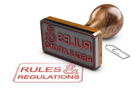 3D illustration of a rubber stamp and the text rules and regulations over white background. Imagens