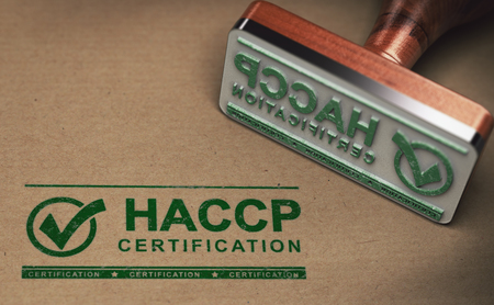 Rubber stamp with the text HACCP certification stamped over cardboard background. 3D illustration.