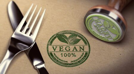 Fork, knife and rubber stamp with the text vegan stamped over cardboard background. Concept of restaurant. 3D illustration.