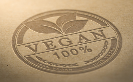 Vegan certified food stamp debossed over brown natural background