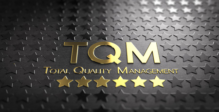 standardization: Accronym TQM and the text Total Quality Management written in gold letters over black background with stars Stock Photo
