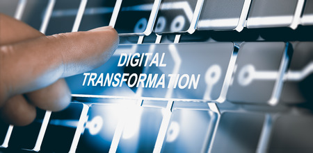 Finger pressing a digital button with the text digital transformation. Concept of digitalization of business processes. Composite between a photography and a 3D background. Horizontal image Stockfoto